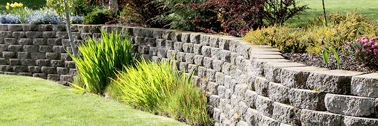 How to Divert Water Away from Foundations with Retaining Walls